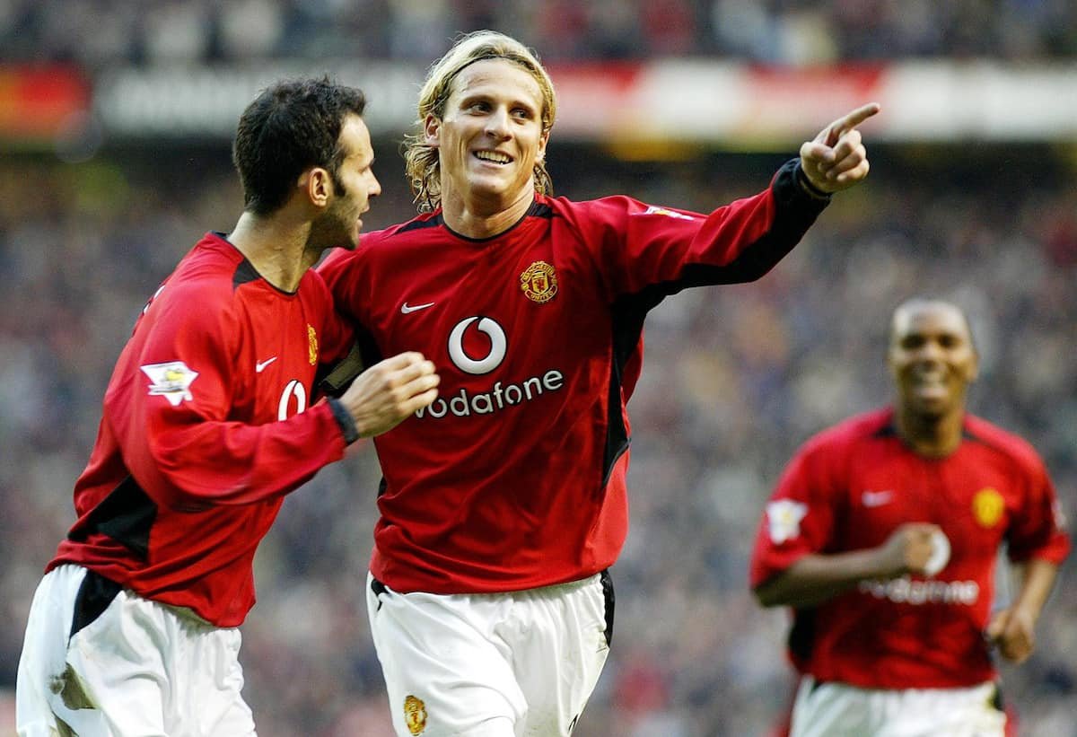 Manchester United's Diego Forlan celebrates with team-mate Ryan Giggs (left) after scoring against Portsmouth during the Barclaycard Premiership match at Old Trafford,   THIS PICTURE CAN ONLY BE USED WITHIN THE CONTEXT OF AN EDITORIAL FEATURE. NO WEBSITE/INTERNET USE UNLESS SITE IS REGISTERED WITH FOOTBALL ASSOCIATION PREMIER LEAGUE.