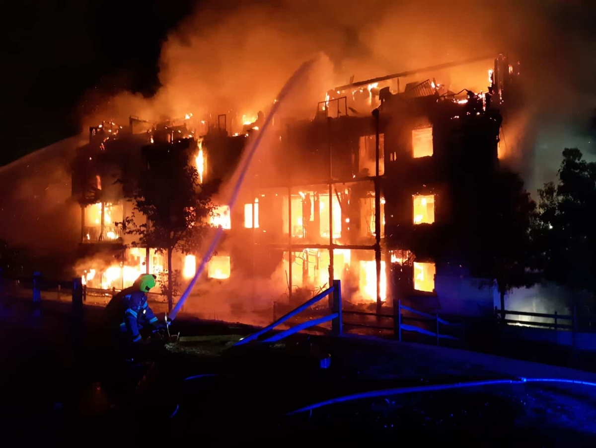 Handout photo taken from the Twitter feed of London Fire Brigade @LondonFire showing a four-storey block of flats engulfed in flames in Sherbrooke Way, Worcester Park, south-west London. A total of 20 fire engines and 125 firefighters were sent to the scene.