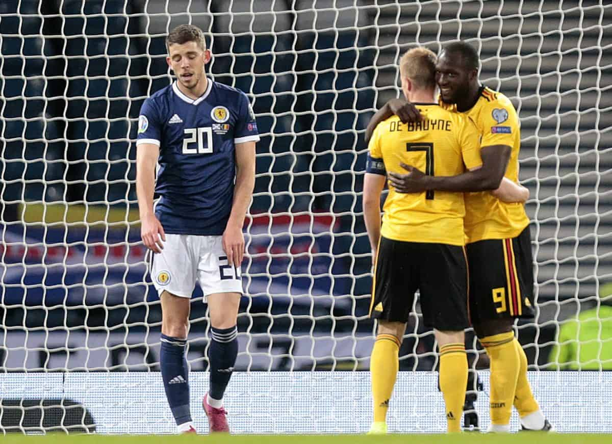 Scotland's Ryan Christie (left) after Belgium's Romelu Lukaku celebrates scoring his side's first goal of the game with Kevin De Bruyne during the UEFA Euro 2020 qualifying group I match at Hampden Park, Glasgow.