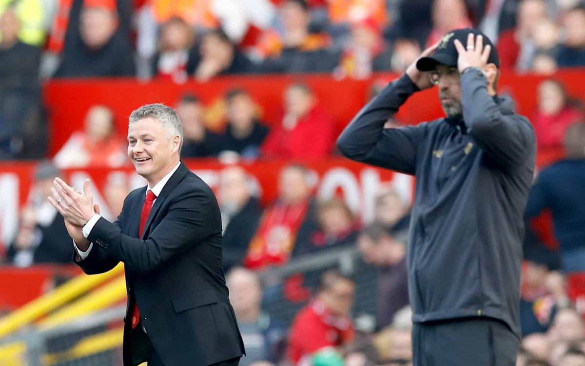 Manchester United caretaker manager Ole Gunnar Solskjaer (left) and Liverpool manager Jurgen Klopp react from the touchline during the Premier League match at Old Trafford, Manchester. Credit;PA