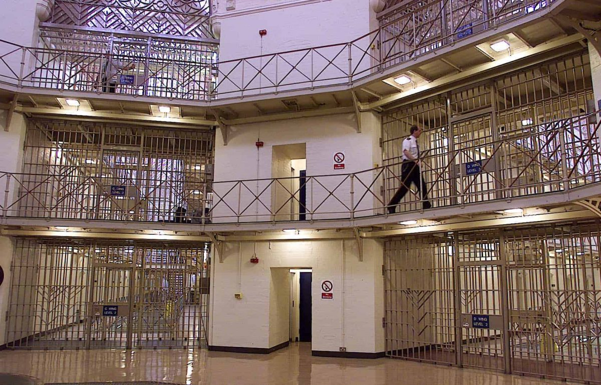 File photo dated 30/03/00 of a prison officer in the Rotunda area of HMP Manchester. The prison has been assessed by inspectors as having made slow and weak progress in many key areas where improvement was urged after a full inspection in 2018.