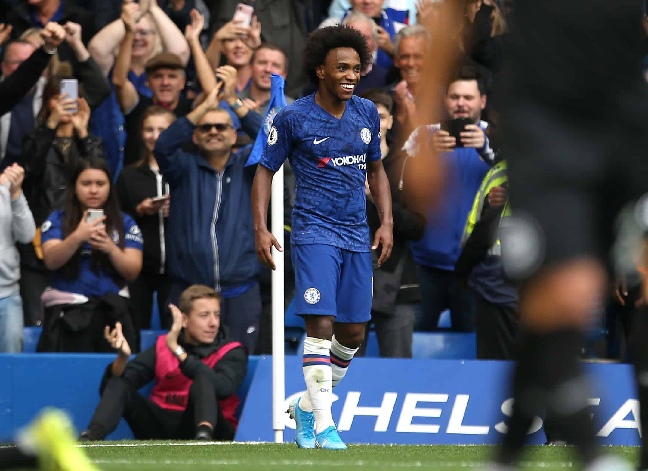 Chelsea's Willian celebrates scoring his side's second goal of the game during the Premier League match at Stamford Bridge, London. Credit;PA