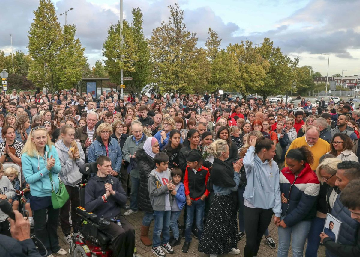 Hundreds of people pay their respects at a vigil outside Hillingdon station in London. Credit;PA