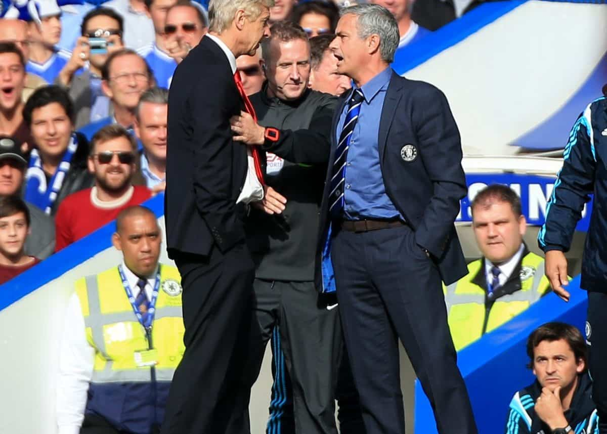 Chelsea manager Jose Mourinho (right) has a heated exchange with Arsenal manager Arsene Wenger (left) on the touchline during the Barclays Premier League match at Stamford Bridge, London. Credit;PA
