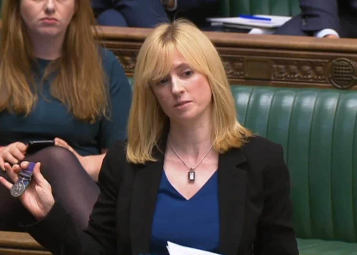 Labour MP for Canterbury, Rosie Duffield, holds up a medal from one of her constituents in the House of Commons in London. Credit;PA