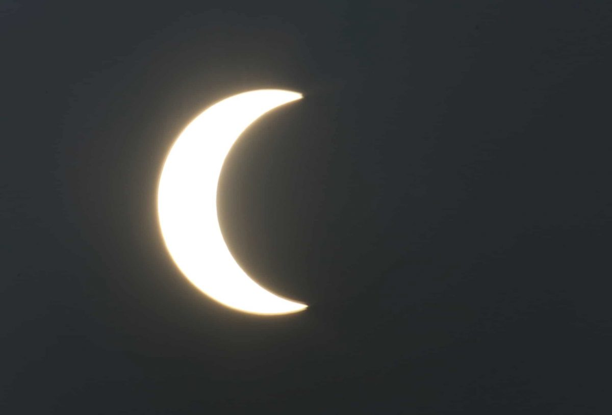 A partial solar eclipse is seen from Karachi, Pakistan, Thursday, Dec. 26, 2019. The last solar eclipse of 2019 was witnessed in Pakistan along with several other countries. (AP Photo/Fareed Khan)
