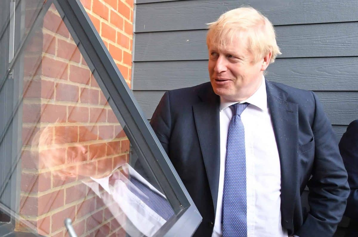 Prime Minister Boris Johnson (right) speaks to Paul O'Rourke, who served with the Royal Irish Rangers, during a visit to a veterans centre in Salisbury, whilst on the General Election campaign trail.