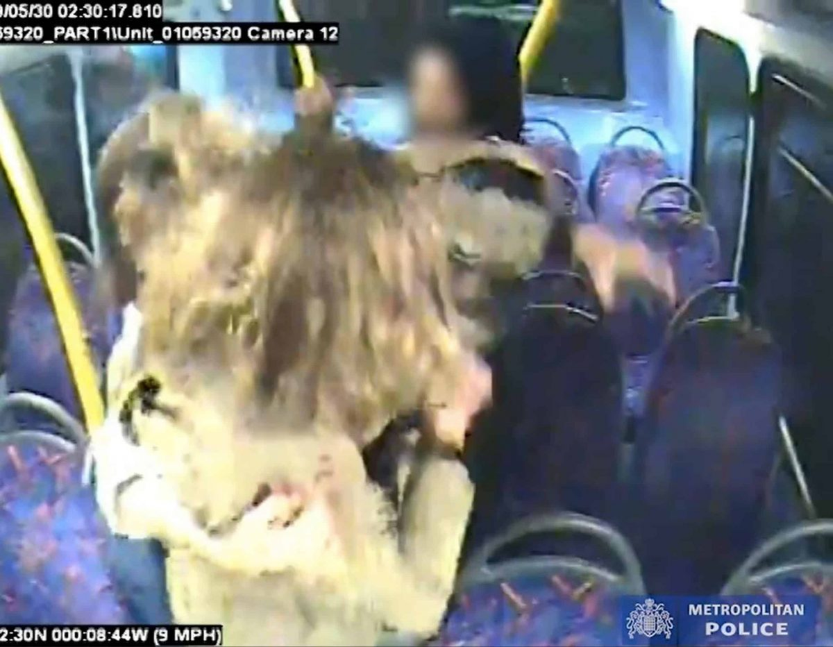 Handout CCTV grab issued by the Metropolitan Police of Melania Geymonat and her girlfriend Christine Hannigan being surrounded by a group on teenagers during an incident on a London bus in the early hours of May 30. A teenager who admitted targeting a same-sex couple on a night bus after they refused to kiss will be sentenced later on Thursday.