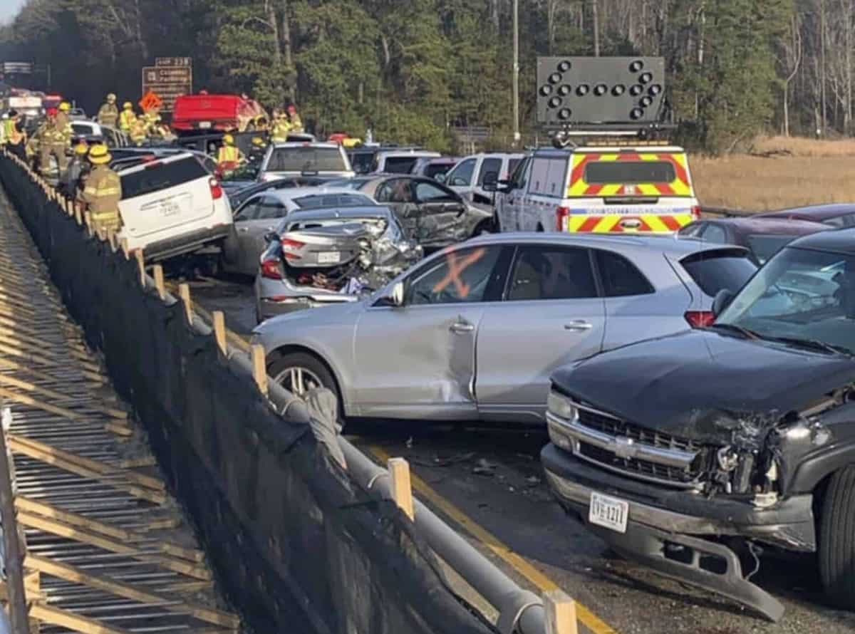In this photo provided by the Virginia State Police, emergency personnel work the scene of a multi-vehicle pileup on Interstate 64 in York County, Va., on Sunday, Dec. 22, 2019. (Virginia State Police via AP)