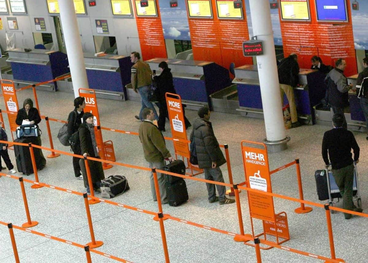 Members of the public wait for flights and transfers at Bristol International Airport as flights are expected to begin arriving again this morning. Credit;PA