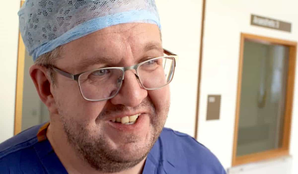 photo of Vascular surgeon Neil Hopper, 43, who had a below-the-knee double amputation after falling ill with sepsis.