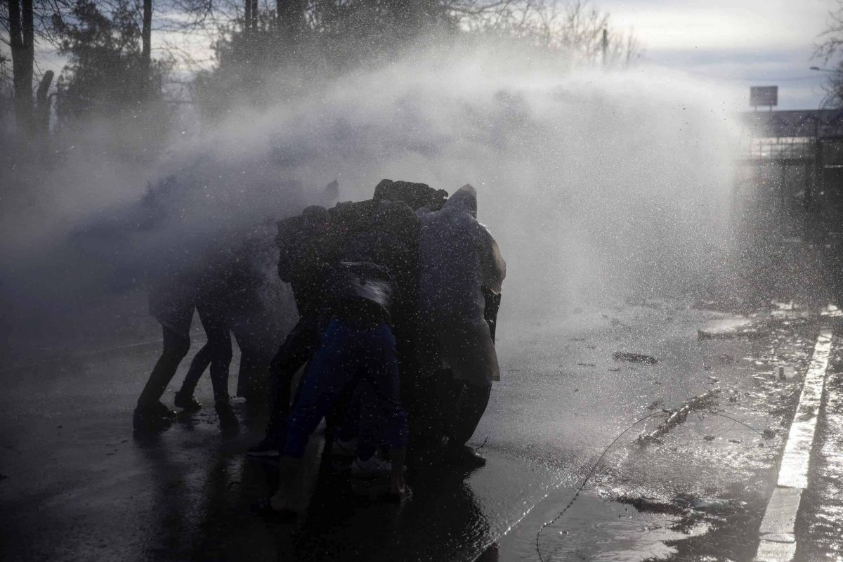 A Greek police water cannon operates from Kastanies border gate as migrants try to enter Greece from the Pazarkule border gate, Turkey at the Turkish-Greek border on Friday, March 6, 2020. Clashes erupted anew on the Greek-Turkish border Friday as migrants attempted to push through into Greece, while the European Union's foreign ministers held an emergency meeting to discuss the situation on the border and in Syria, where Turkish troops are fighting. (AP Photo)
