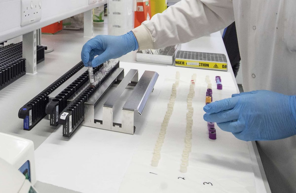 Clinical support technician Douglas Condie extracts viruses from swab samples so that the genetic structure of a virus can be analysed and identified in the coronavirus testing laboratory at Glasgow Royal Infirmary, Glasgow.