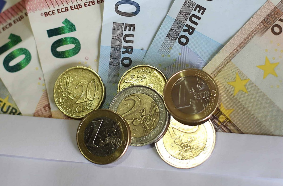 Stock picture of euro notes and coins.