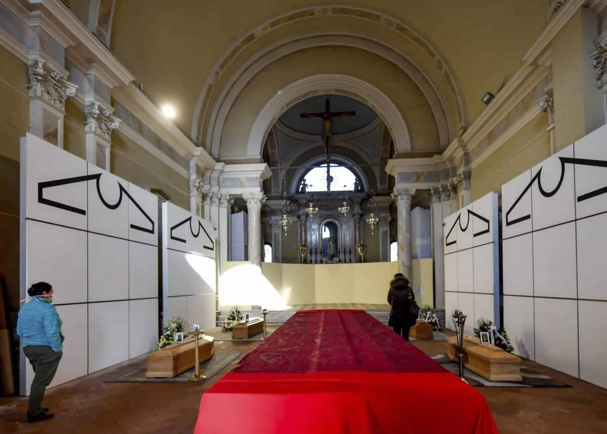 Coffins wait to be transported to cemetery, in the church of Zogno, near Bergamo, Northern Italy, Saturday, March 21, 2020. Italy's tally of coronavirus cases and deaths keeps rising, with new day-to-day highs: 793 dead and 6,557 new cases. For most people, the new coronavirus causes only mild or moderate symptoms. For some it can cause more severe illness. (Claudio Furlan/LaPresse via AP)
