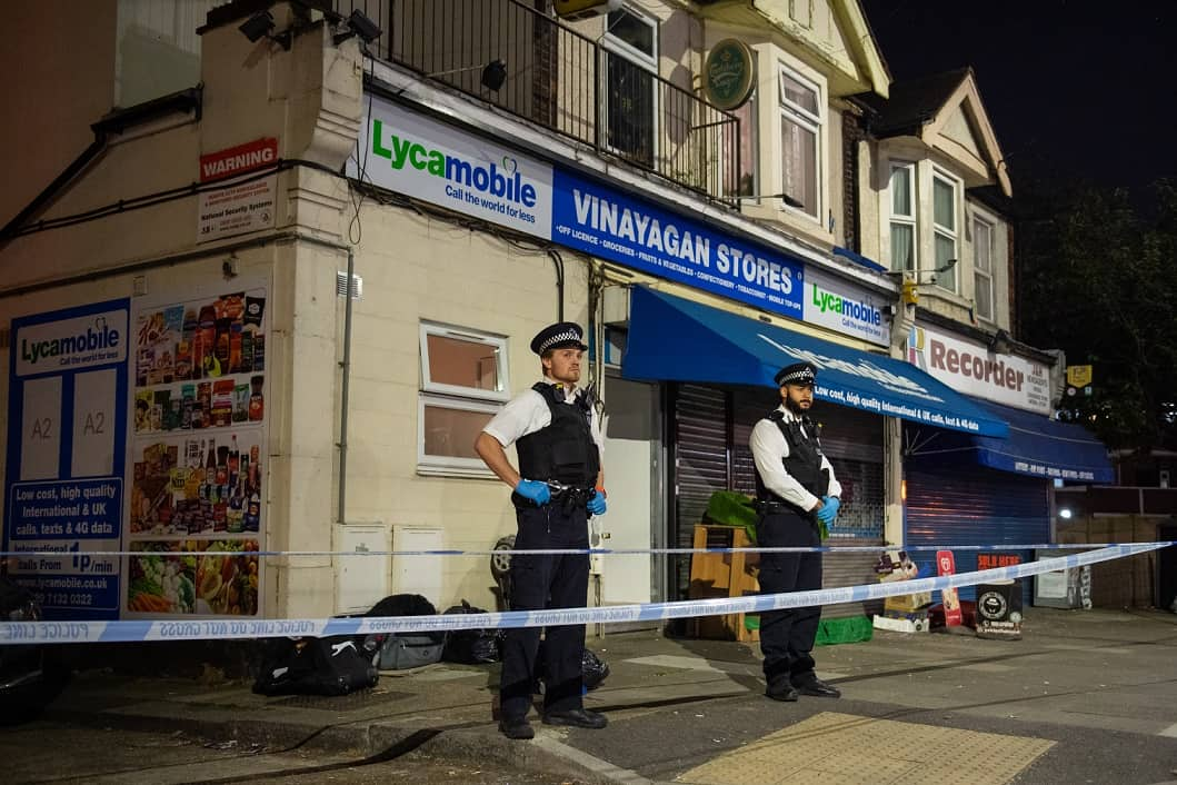 Police attend the scene in Aldborough Road North, Ilford, east London where a baby girl and a boy aged three have been stabbed to death while a 40-year-old man was found injured and was taken to hospital.