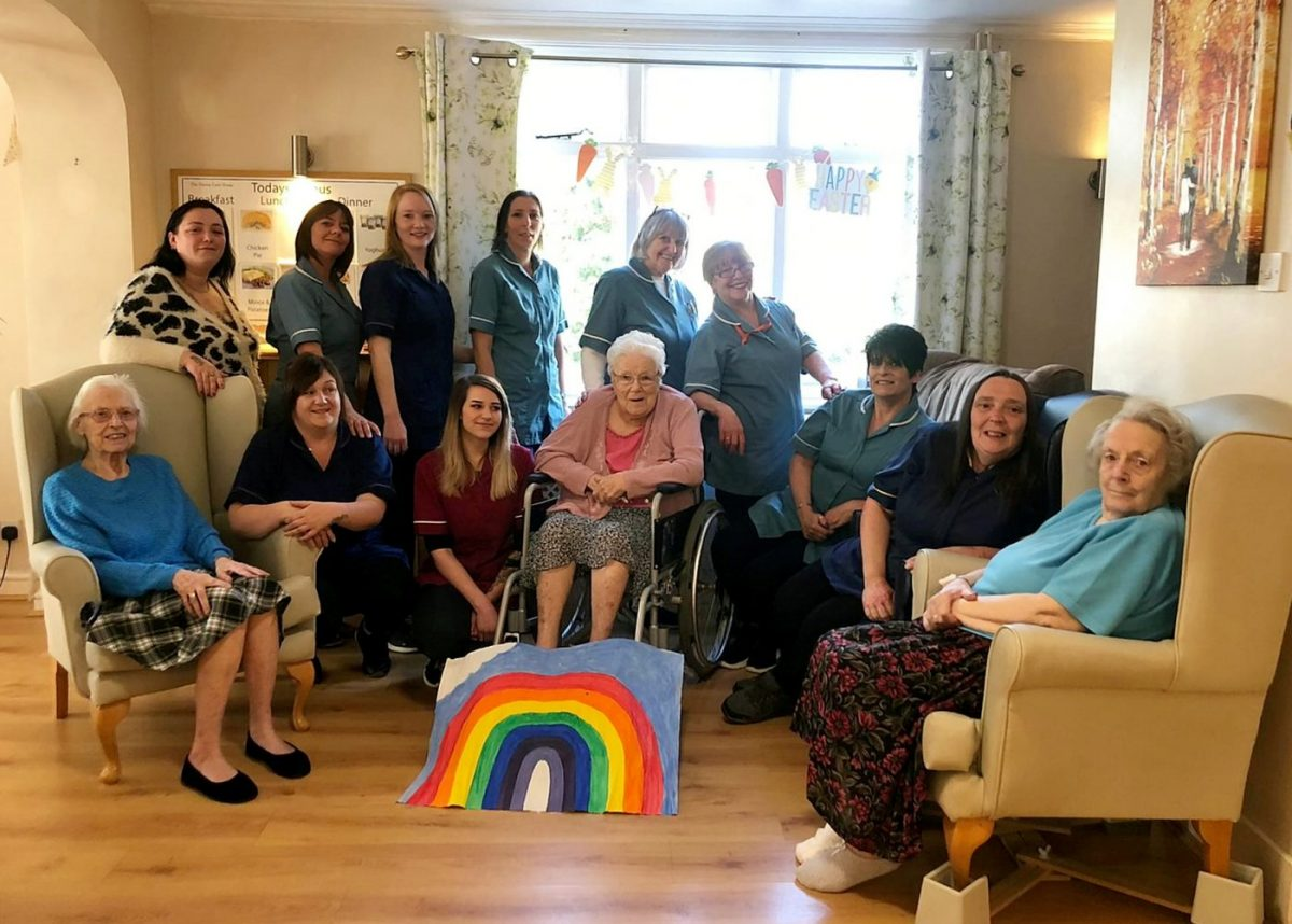 Back row (left to right): Amie Clark, Amanda Taylor, Harriet Mays, Andrea Stockman, Marah Knight, Ornella Phillips.  Front row (left to right): Resident, Sharon Scull, Hannah Richardson, Resident, Helen Lane, Bridie Hancock, Resident.  A group of care workers have chosen to look after their elderly patients during the coronavirus lockdown - instead of living with their own families.  Credit;SWNS