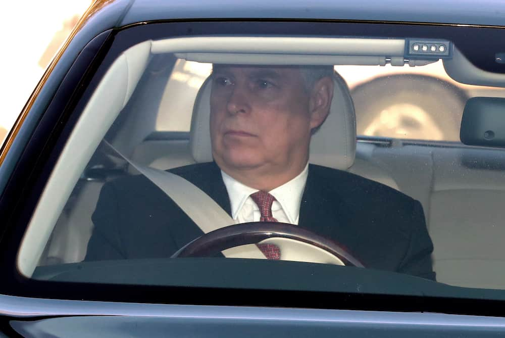The Duke of York drives his Bentley into Buckingham Palace, London as he arrives for the Queen's Christmas lunch.
