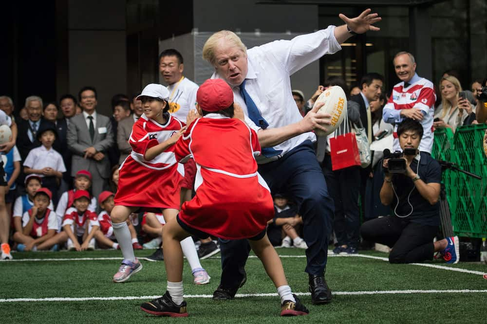 Mayor of London Boris Johnson joins a Street Rugby tournament in a Tokyo street with school children and adults from Nihonbashi, Yaesu & Kyobashi Community Associations, to mark Japan hosting 2019 Rugby World Cup where Mr Johnson is on the final day of his four day trade visit to Japan.Credit;PA