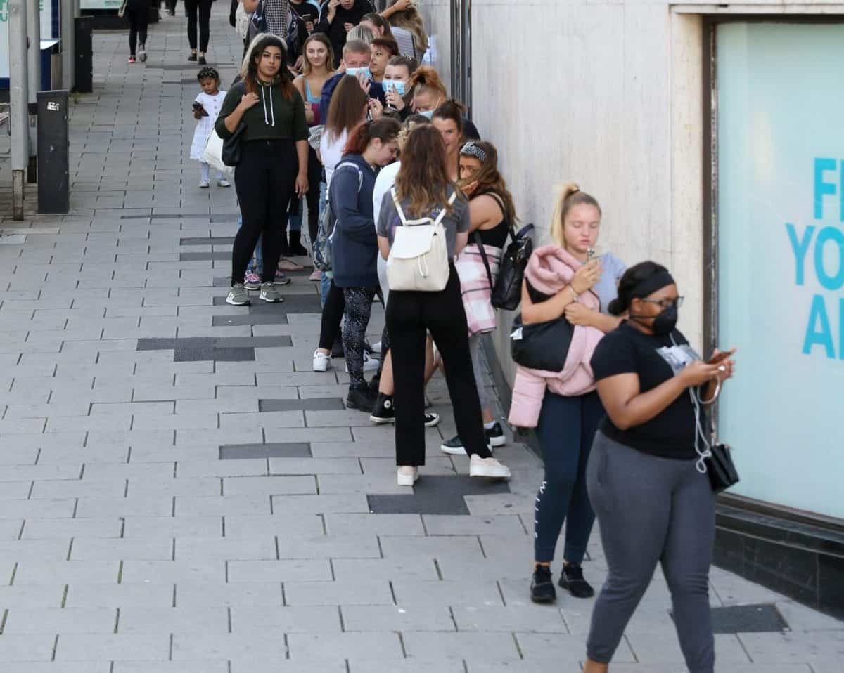 Shoppers queue outside Primark in Bristol on the first day that non essential shops are allowed to opening following coronavirus restrictions, June 15 2020. Credit;SWNS