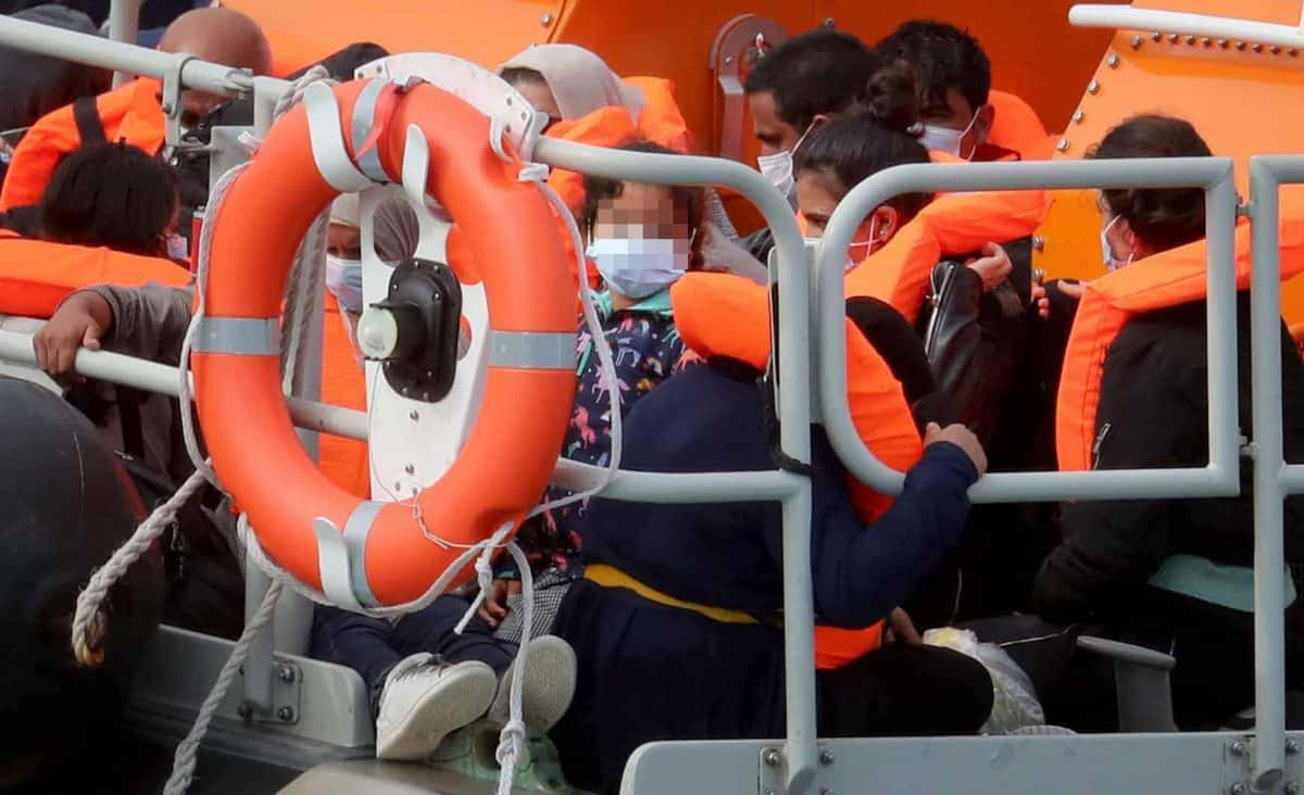NOTE: FACES HAVE BEEN PIXELATED BY THE PA PICTURE DESK TO PROTECT IDENTITY OF ANY MINORS PRESENT A group of people thought to be migrants are brought into Dover, Kent, onboard the Dover RNLI lifeboat following a number of small boat incidents in the Channel earlier today.