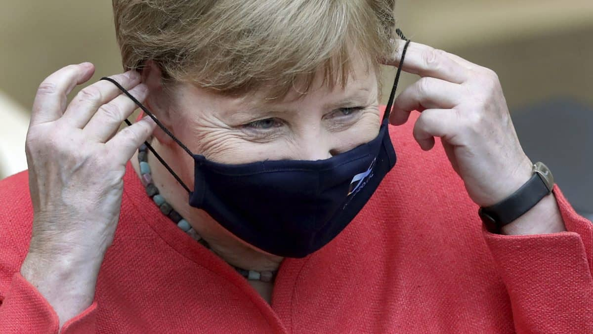 German Chancellor Angela Merkel adjusts her face mask as she arrives for a meeting of the upper house of the German legislative in Berlin, Germany, Friday, July 3, 2020. (AP Photo/Michael Sohn)