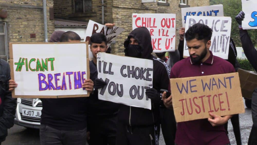 People with placards, gathered for a demonstration outside Halifax police station on Wednesday afternoon. A West Yorkshire officer has been suspended after a video was widely shared of Hassan Ahmed, 27, being arrested in Halifax on Sunday. Safyah is Hassan Ahmed's sister.Credit;PA