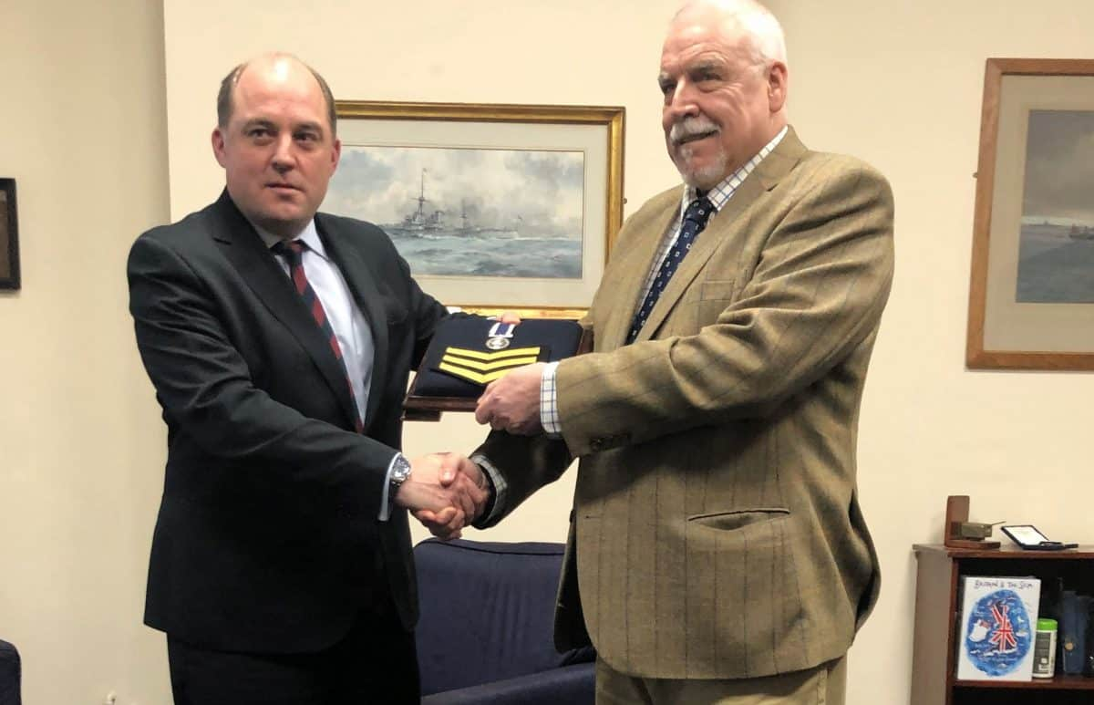 Handout photo issued by Liberty of Falklands veteran Joe Ousalice (right), 68, being given his medal for long service and good conduct by Defence Secretary Ben Wallace.