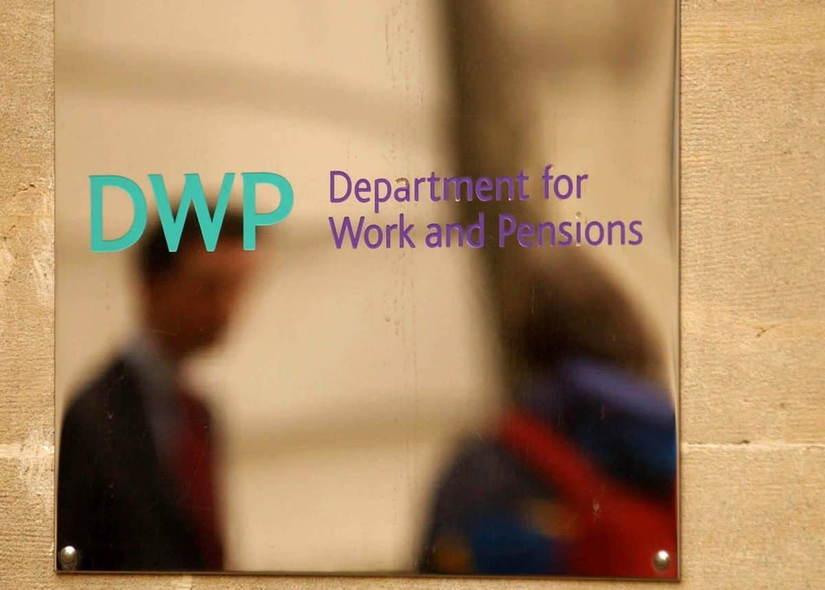Undated file photo of the sign outside the Department of Works and Pensions in central London. New benefits claimants should be given financial support while they wait for their first Universal Credit payment, MPs have said.