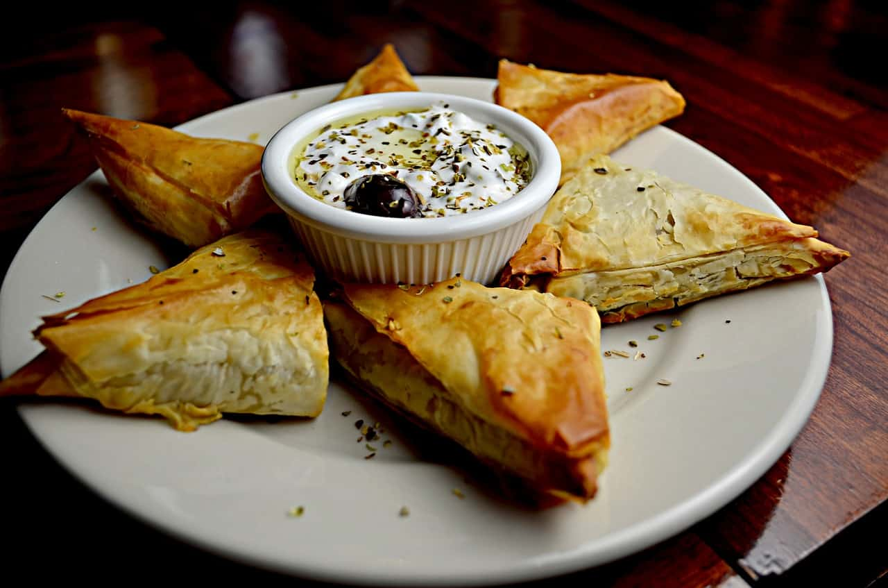 Filo pastry parcels with feta, couscous, and dates