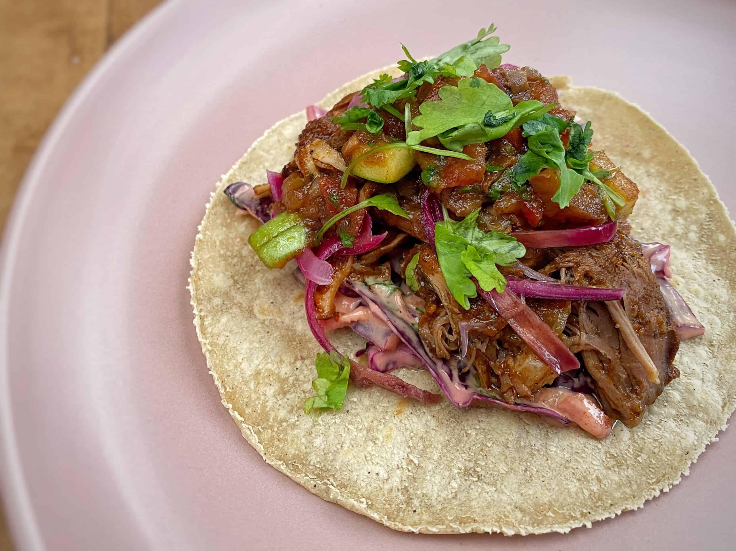 Pork tacos with brown sauce salsa