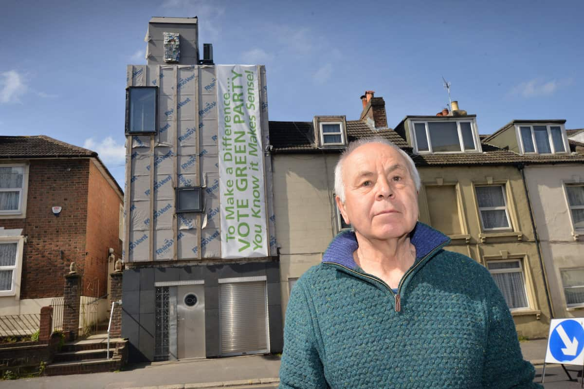 Ken Davis and his Zero carbon house in Bohemia Road, Hastings. See SWNS story SWNNeco. A green homeowner who is building the first zero carbon house in the area has been ordered to remove a storey of the renovation by the council.  Ken Davis is doing up a house in St Leonards, East Sussex, to make it the borough's first zero carbon home. But the project has been delayed after the local council asked him to get rid one storey of the building after an application to extend and alter the property was refused.