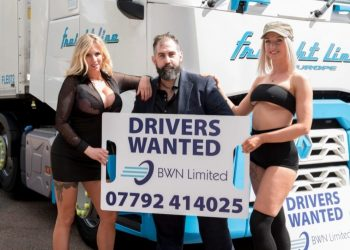 Adam Giles (middle) advertising lorry drivers vacancies