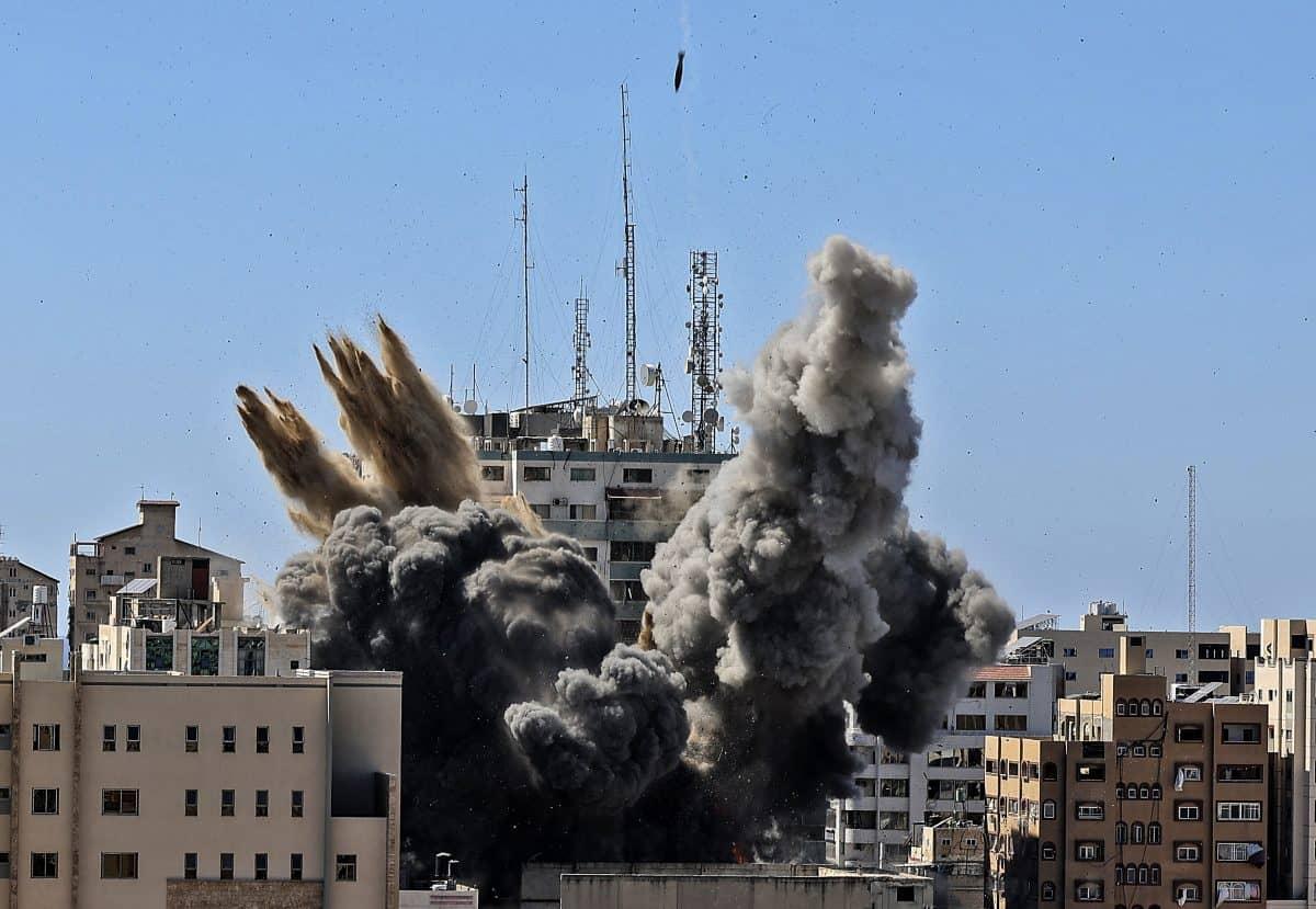 A bomb hits the building housing various international media (Mahmud Hams /Pool Photo via AP/PA)