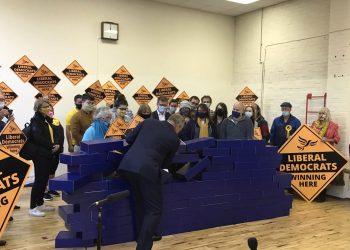 Ed Davey demolishing the blue wall after the Lib Dem victory in Chesham and Amersham