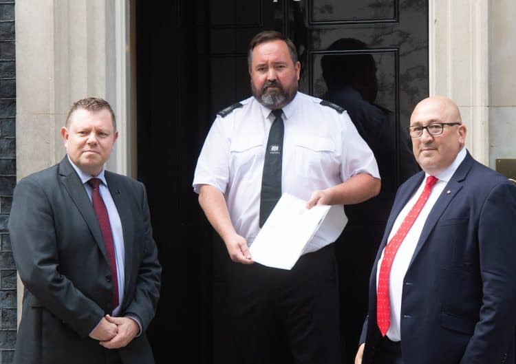 John Apter from Police Federation and Ken Marsh from the Met Federation. Credit;SWNS