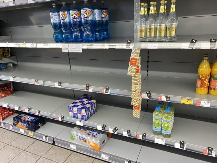 """Photo taken with permission from the Twitter feed of @HapG86 of empty shelves in a Co-op. The shop replied to the Twitter user putting the low stock down to how many staff were self-isolating. Retailers are under """"increasing pressure"""" to keep shelves fully stocked amid staff shortages caused by the """"pingdemic"""", industry bosses have warned. Issue date: Wednesday July 21, 2021."""
