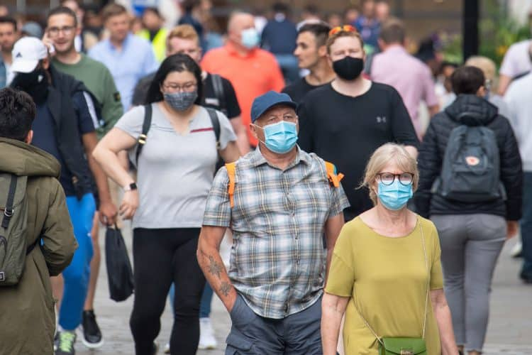 """People wearing face masks among crowds of pedestrians in Covent Garden, London. Rumours were abound in the Sunday newspapers that Prime Minister Boris Johnson, who is due to update the nation this week on plans for unlocking, is due to scrap social distancing and mask-wearing requirements on so-called """"Freedom Day"""". Picture date: Sunday July 4, 2021."""