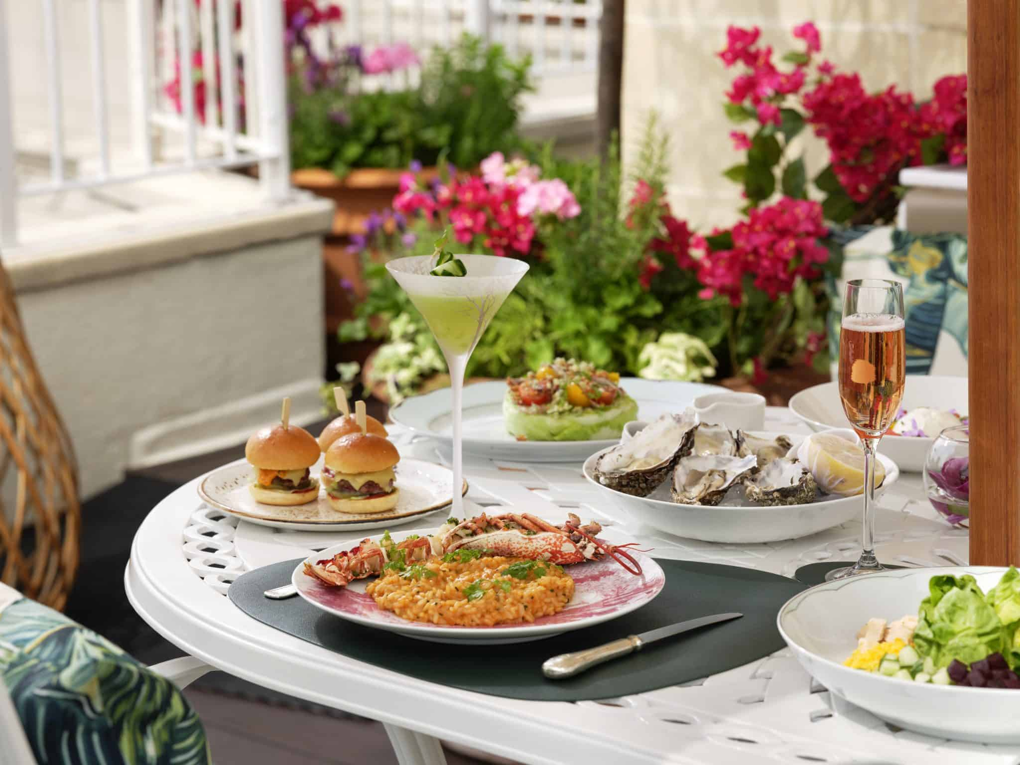 The Dorchester Rooftop-BHH Polo Lounge pop up-table spread-highres-landscape