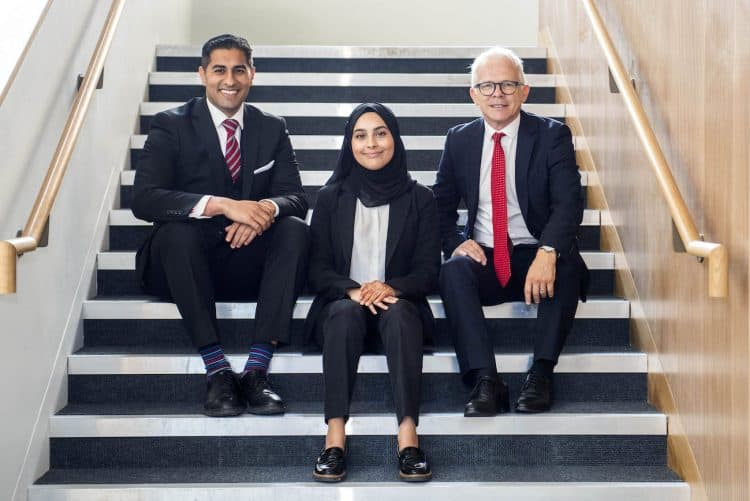 (L-R) NCS headteacher Mouhssin Ismail, student Ayesha Karim and City of London Academy CEO  Mark Emmerson. Credit;SWNS