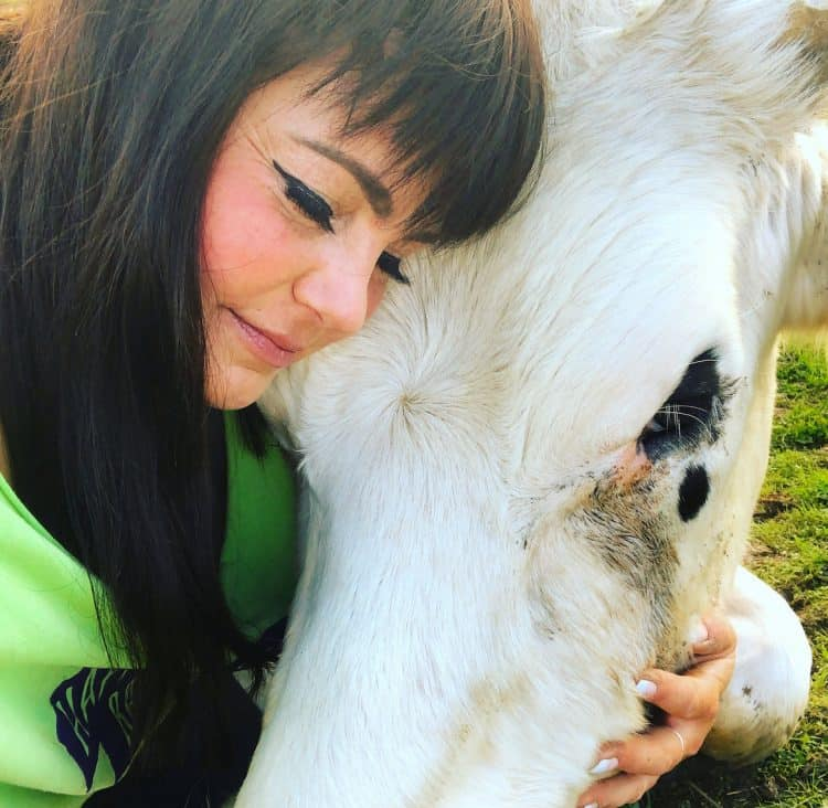 Amey James with her animals. Credit;SWNS