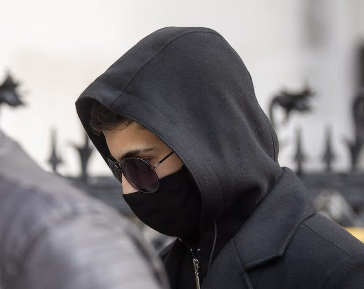 """Syrian schoolboy Jamal Hijazi, 17, arrives at the Royal Courts of Justice, London, where he is suing English Defence League founder Tommy Robinson - whose real name is Stephen Yaxley-Lennon - after Robinson commented about a video of Mr Hijazi being attacked in a school playground, claiming he was """"not innocent and he violently attacks young English girls in his school"""". Picture date: Wednesday April 21, 2021."""