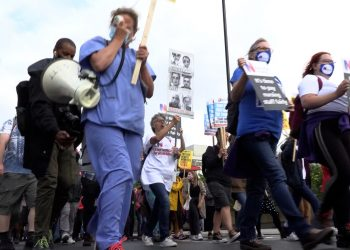 Health workers march to Downing Street, London. Credit;PA