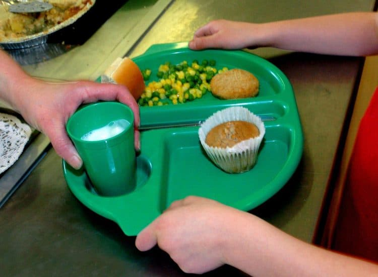 File photo dated 28/08/09 of a school meal being served. Around three in 10 school-aged children have registered for free school meals this autumn, research for food poverty campaigners suggests.