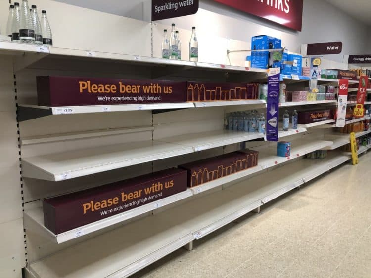 """Empty shelves and signs on the soft drinks aisle of a Sainsbury's store in Blackheath, Rowley Regis in the West Midlands. Supermarkets have urged customers not to panic buy in response to reports of emptying shelves, saying they are continuing to receive regular deliveries. The UK's biggest supermarkets described any shortages as """"patchy"""" across stores but said there was no need for customers to change their shopping habits. Picture date: Thursday July 22, 2021."""