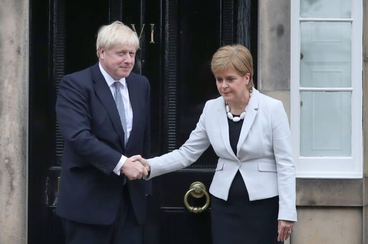 RETRANSMITTED CORRECTING BYLINE Scotland's First Minister Nicola Sturgeon welcomes Prime Minister Boris Johnson outside Bute House in Edinburgh ahead of their meeting.