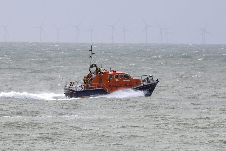 A RNLI lifeboat continues it search for the missing two fishermen that went missing near Seaford, Sussex, after their fishing boat, Joanna C, sank off the coast near Seaford, East Sussex on Saturday.