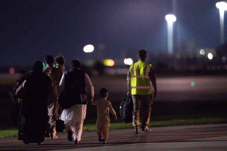 British nationals and Afghan evacuees depart a flight from Afghanistan at RAF Brize Norton. Picture date: Thursday August 26, 2021.