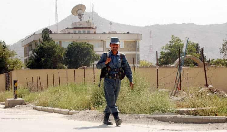 A guard walks in front of the British Embassy in Kabul, Afghanistan.