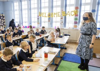 P3 teacher Jessica Cargill with her class at Springfield Primary School in Belfast. Today marks the first day back for Pre-school, nursery and primary school pupils in P1-P3 have retruned to classrooms across Northern Ireland. Picture date: Monday March 8, 2021.